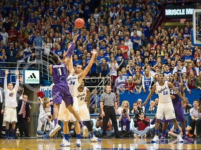 (Photo by Emily DeShazer | The Collegian)  K-State senior guard Shane Southwell shoots over Kansas sophomore Perry Ellis as the shot clock expires on Jan. 11 at Allen Fieldhouse.