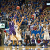 (Photo by Emily DeShazer | The Collegian)<br /> <br /> K-State senior guard Shane Southwell shoots over Kansas sophomore Perry Ellis as the shot clock expires on Jan. 11 at Allen Fieldhouse.