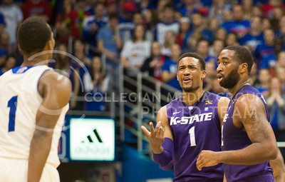 (Photo by Emily DeShazer | The Collegian)  K-State senior guard Shane Southwell talks to Kansas freshman guard Wayne Selden Jr. on Jan. 11 at Allen Fieldhouse.