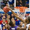 (Photo by Emily DeShazer | The Collegian)  Kansas freshman center Joel Embiid blocks K-State freshman guard Jevon Thomas's shot at Allen Fieldhouse on Jan. 11.  KU beat K-State 86-60 in the first half of the annual Sunflower Showdown.