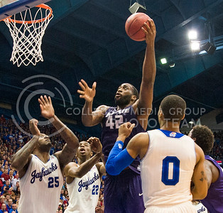 (Photo by Emily DeShazer | The Collegian)  K-State junior forward Thomas Gipson puts up a shot while surrounded by Kansas defenders on Jan. 11 at Allen Fieldhouse.