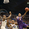 (Photo by Emily DeShazer | The Collegian)<br /> <br /> K-State freshman guard Marcus Foster takes a shot on Jan. 11 at Allen Fieldhouse.