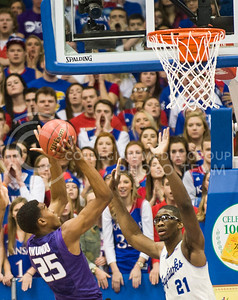 (Photo by Emily DeShazer | The Collegian)  K-Staet freshman forward Wesley Iwundu shoots over Kansas center Joel Embiid on Jan. 11 at Allen Fieldhouse.