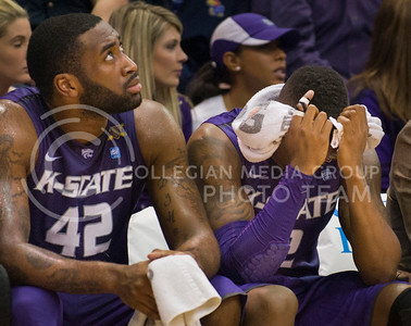 (Photo by Emily DeShazer | The Collegian)  K-State junior forward Thomas Gipson looks at the scoreboard as Marcus Foster holds his head during the 86-60 loss to Kansas on Jan. 11 at Allen Fieldhouse.