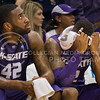 (Photo by Emily DeShazer | The Collegian)<br /> <br /> K-State junior forward Thomas Gipson looks at the scoreboard as Marcus Foster holds his head during the 86-60 loss to Kansas on Jan. 11 at Allen Fieldhouse.