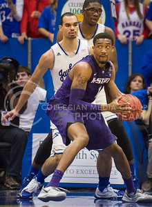 (Photo by Emily DeShazer | The Collegian)  K-State senior guard Shane Southwell looks to pass on Jan. 11 at Allen Fieldhouse.