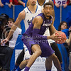 (Photo by Emily DeShazer | The Collegian)<br /> <br /> K-State senior guard Shane Southwell looks to pass on Jan. 11 at Allen Fieldhouse.