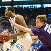 (Photo by Emily DeShazer | The Collegian)  K-State senior guard Will Spradling reaches around Kansas freshman guard Wayne Selden Jr. for the ball on Jan. 11 at Allen Fieldhouse.