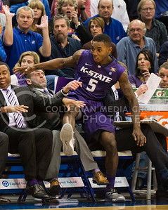(Photo by Emily DeShazer | The Collegian)  K-State freshman guard Jevon Thomas falls in to the K-State bench on Jan. 11 at Allen Fieldhouse.