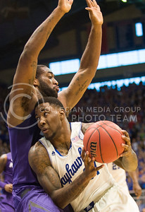 (Photo by Emily DeShazer | The Collegian)  K-State junior forward Thomas Gipson defends Kansas sophomore forward Jamari Traylor's track to the basket on Jan. 11 at Allen Fieldhouse.