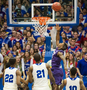 (Photo by Emily DeShazer | The Collegian)  K-State freshman guard Jevon Thomas completes a lay up on Jan. 11 at Allen Fieldhouse.