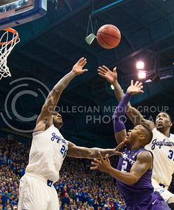 (Photo by Emily DeShazer | The Collegian)  K-State freshman guard Marcus Foster shoots over the outstretched arms of Kansas forwards Tarik Black and Jamari Traylor on Jan. 11 at Allen Fieldhouse.