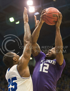 (Photo by Emily DeShazer | The Collegian)  K-State senior guard Omari Lawrence shoots over Kansas senior forward Tarik Black on Jan. 11 at Allen Fieldhouse.