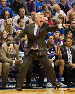 (Photo by Emily DeShazer | The Collegian)  K-State head coach yells at his team to get in to position on Jan. 11 at Allen Fieldhouse.