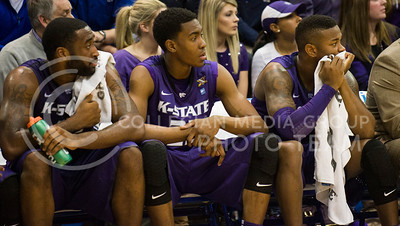 (Photo by Emily DeShazer | The Collegian)  K-State starters Thomas Gipson, Wesley Iwundu and Marcus Foster watch from the bench as K-State falls behind by more than 20 points on Jan. 11 at Allen Fieldhouse.