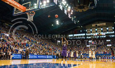 (Photo by Emily DeShazer | The Collegian)  K-State junior forward Nino Williams shoots a free throw after a flagrant foul by Kansas freshman center Joel Embiid on Jan. 11 at Allen Fieldhouse.
