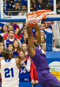 (Photo by Emily DeShazer | The Collegian)  K-State junior forward Thomas Gipson dunks on Jan. 11 at Allen Fieldhouse.