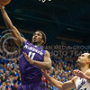 (Photo by Emily DeShazer | The Collegian)<br /> <br /> K-State junior forward Nino Williams lays in a basket as Kansas sophomore Perry Ellis watches on Jan. 11 at Allen Fieldhouse.