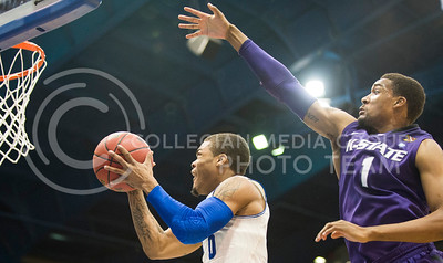 (Photo by Emily DeShazer | The Collegian)  Kansas freshman guard Frank Mason shoots as K-State senior guard Shane Southwell tries to block the shot on Jan. 11 at Allen Fieldhouse.