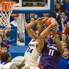 (Photo by Emily DeShazer | The Collegian)<br /> <br /> K-State junior forward Nino Williams fights for the rebound with Kansas sophomore forward Perry Ellis on Jan. 11 at Allen Fieldhouse.