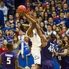 (Photo by Emily DeShazer | The Collegian)  Kansas freshman Andrew Wiggins shoots over K-State junior forward Thomas Gipson at Allen Fieldhouse on Jan. 11.