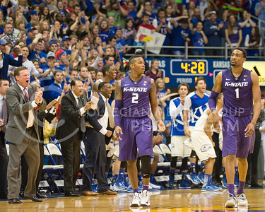(Photo by Emily DeShazer | The Collegian)  Kansas coaches and fans celebrate as K-State's Marcus Foster, Shane Southwell and the team are assessed a shot clock violation.