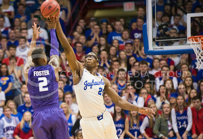 (Photo by Emily DeShazer | The Collegian)  K-State freshman guard Marcus Foster shoots a three as Kansas freshman center Joel Embiid blocks his shot on Jan. 11 at Allen Fieldhouse.