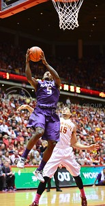(Photo by Parker Robb | Collegian)  Freshman guard Jevon Thomas goes up for a layup and is fouled by ISU guard Naz Long during the second half of K-State's 81-75 loss to the Cyclones January 25, 2014, in Hilton Coliseum in Ames, Iowa. The Wildcats were down 52-55 with 9:59 remaining when Thomas made one of his two following free throws.