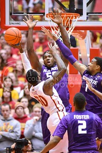 (Photo by Parker Robb | Collegian)  Sophomore forward D.J. Johnson (50) and senior forward Shane Southwell (1) attempt to block a shot from ISU guard DeAndre Kane during the second half of K-State's 81-75 loss to the Cyclones January 25, 2014, in Hilton Coliseum in Ames, Iowa. Johnson came away with the defensive rebound.