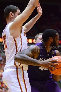 (Photo by Parker Robb | Collegian)  Junior forward Thomas Gipson looks for another way around ISU forward Georges Niang during the first half of K-State's 81-75 loss to the Cyclones January 25, 2014, in Hilton Coliseum in Ames, Iowa.