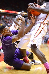 (Photo by Parker Robb | Collegian)  Freshman forward Marcus Foster reaches for the ball as it is snatched away from him by Iowa State forward Dustin Hogue during the second half of K-State's 81-75 loss to the Cyclones January 25, 2014, in Hilton Coliseum in Ames, Iowa. The jump ball with 1:11 remaining was given to the Wildcats.
