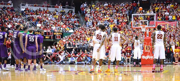 (Photo by Parker Robb | Collegian)  Following a lengthy delay while officials sorted out a contested tie-up, K-State and Iow State players watch as Iowa State forward Melvin Ejim shoots two free throws for Spradling's personal foul. Officials ruled that Spradling committed a personal foul, while Ejim got a technical, and they awarded ISU two free throws, and K-State two free throws and then the following ball possession.