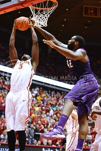 (Photo by Parker Robb | Collegian)  Junior forward Thomas Gipson tries to grab an offensive rebound from ISU forward Melvin Ejim during the second half of K-State's 81-75 loss to the Cyclones January 25, 2014, in Hilton Coliseum in Ames, Iowa. The Wildcats were down 52-63, but clawed back to tie the score a few minutes later.