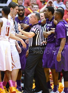 (Photo by Parker Robb | Collegian)  Referees break up a scuffle between K-State and Iowa State players following a contested jump ball tie-up with 3:46 remaining in the second half of K-State's 81-75 loss to the Cyclones January 25, 2014, in Hilton Coliseum in Ames, Iowa. Play was stopped for an unusually long time as officials tried to sort out exactly what happened when Spradling and Ejim dove for the ball and got entangled.