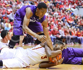 (Photo by Parker Robb | Collegian)  Freshman forward Wesley Iwundu attempts to steal a loose ball snatched up by Iowa State forward Melvin Ejim during the first half of K-State's 81-75 loss to the Cyclones January 25, 2014, in Hilton Coliseum in Ames, Iowa.