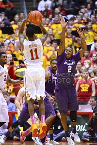 (Photo by Parker Robb | Collegian)  Freshman guard Marcus Foster jumps in front of a three-point shot attempt from ISU guard Monte Morris during the first half of K-State's 81-75 loss to the Cyclones January 25, 2014, in Hilton Coliseum in Ames, Iowa. Morris missed the three-pointer with 8:55 remaining in the first half.