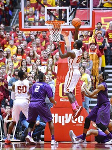 (Photo by Parker Robb | Collegian)  Iowa State forward Dustin Hogue makes a layup as freshman guard Marcus Foster and freshman forward Wesley Iwundu look on four minutes into the second half of K-State's 81-75 loss to the Cyclones January 25, 2014, in Hilton Coliseum in Ames, Iowa. The Wildcats went on a 9-0 run to start the second half, which was snapped by Hogue's layup, clawing back within three points of Iowa State.