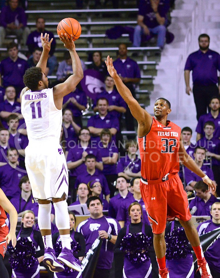 (Photo by Parker Robb | Collegian)<br /> <br /> Junior forward Nino Williams takes a jumper over the head of Texas Tech forward Jordan Tolbert during the first half of the Wildcats' 66-58 defeat of the Red Raiders January 28, 2014, in Bramlage Coliseum. Williams recorded 13 points in the game, including 5 of 7 field goals.