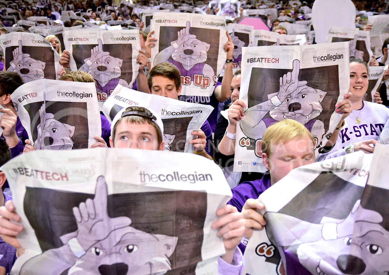 (Photo by Parker Robb | Collegian)<br /> <br /> K-State students read the newspaper and display their dislike of the Texas Tech basketball team during the presentation of the Red Raiders' starting lineup before their defeat at the hands of the Wildcats January 28, 2014, in Bramlage Coliseum.