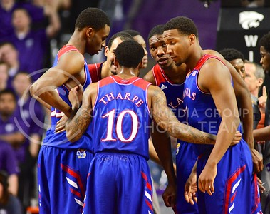 (Photo by Parker Robb | Collegian)  The Jayhawks huddle after a foul in the second half of K-State's 85-82 overtime upset victory over the #7-ranked Jayhawks in the 279th Sunflower Showdown February 10, 2014, in Bramlage Coliseum. (Photo by Emily DeShazer | The Collegian)
