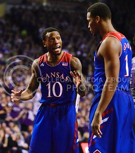 (Photo by Parker Robb | Collegian)  Kansas junior guard Naadir Tharpe tries to talk to freshman guard Wayne Selden, Jr., amidst the overpowering loudness of a completely-full Bramlage Coliseum in the second half of K-State's 85-82 overtime upset victory over the #7-ranked Jayhawks in the 279th Sunflower Showdown February 10, 2014, in Bramlage Coliseum. (Photo by Emily DeShazer | The Collegian)