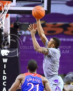 (Photo by Parker Robb | Collegian)  Freshman guard Marcus Foster goes up for a layup in the first half of K-State's 85-82 overtime upset victory over the #7-ranked Jayhawks in the 279th Sunflower Showdown February 10, 2014, in Bramlage Coliseum. (Photo by Emily DeShazer | The Collegian)