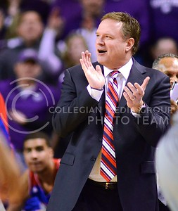(Photo by Parker Robb | Collegian)  Kansas head coach Bill Self applauds his team in the first half of K-State's 85-82 overtime upset victory over the #7-ranked Jayhawks in the 279th Sunflower Showdown February 10, 2014, in Bramlage Coliseum. (Photo by Emily DeShazer | The Collegian)