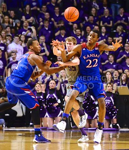 (Photo by Parker Robb | Collegian)  Senior guard Will Spradling (55) gets entangled with Kansas freshman guard Andrew Wiggins (22) and freshman guard Wayne Selden, Jr., going for the ball in the second half of K-State's 85-82 overtime upset victory over the #7-ranked Jayhawks in the 279th Sunflower Showdown February 10, 2014, in Bramlage Coliseum. (Photo by Emily DeShazer | The Collegian)