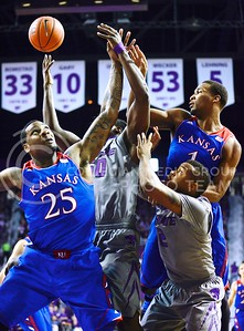 (Photo by Parker Robb | Collegian)  Arms flail as Kansas' senior forward Tarik Black (25) and freshman guard Wayne Selden, Jr., (1) battle freshman guard Marcus Foster (2) and sophomore forward D.J. Johnson (50) for the ball in the first half of K-State's 85-82 overtime upset victory over the #7-ranked Jayhawks in the 279th Sunflower Showdown February 10, 2014, in Bramlage Coliseum. (Photo by Emily DeShazer | The Collegian)