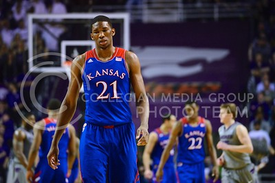 (Photo by Parker Robb | Collegian)  Kansas freshman center Joel Embiid slowly walks downcourt after committing a foul in the second half of K-State's 85-82 overtime upset victory over the #7-ranked Jayhawks in the 279th Sunflower Showdown February 10, 2014, in Bramlage Coliseum. (Photo by Emily DeShazer | The Collegian)