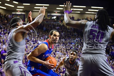 (Photo by Parker Robb | Collegian)  Junior forward Thomas Gipson (left) and sophomore forward D.J. Johnson prepare to block Kansas sophomore forward Perry Ellis as he prepares to go up for a shot in the first half of K-State's 85-82 overtime upset victory over the #7-ranked Jayhawks in the 279th Sunflower Showdown February 10, 2014, in Bramlage Coliseum. (Photo by Emily DeShazer | The Collegian)