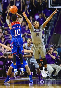 (Photo by Parker Robb | Collegian)  Freshman guard Marcus Foster attempts to block a three-point shot from Kansas junior guard Naadir Tharpe in the second half of K-State's 85-82 overtime upset victory over the #7-ranked Jayhawks in the 279th Sunflower Showdown February 10, 2014, in Bramlage Coliseum. (Photo by Emily DeShazer | The Collegian)