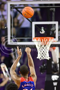 (Photo by Parker Robb | Collegian)  Kansas freshman center Joel Embiid makes a free throw in the second half of K-State's 85-82 overtime upset victory over the #7-ranked Jayhawks in the 279th Sunflower Showdown February 10, 2014, in Bramlage Coliseum. (Photo by Emily DeShazer | The Collegian)
