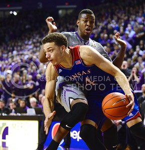 (Photo by Parker Robb | Collegian)  Kansas freshman guard Brannen Greene dribbles into freshman guard Marcus Foster in the first half of K-State's 85-82 overtime upset victory over the #7-ranked Jayhawks in the 279th Sunflower Showdown February 10, 2014, in Bramlage Coliseum. (Photo by Emily DeShazer | The Collegian)